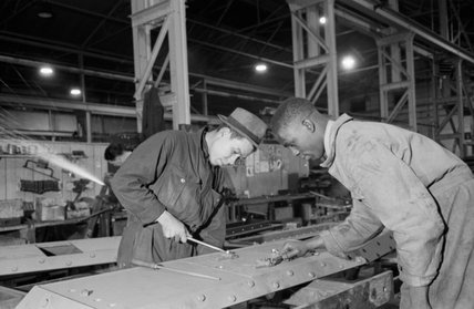 Jamaican technicians working in a tank factory in the north of England during the Second World War.