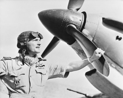 Wing Commander Frank Carey, Officer Commanding the Air Firing Training Unit, based at Amarda Road, India, standing by the nose of a Hawker Hurricane, April 1943.