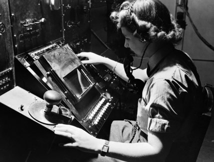 WAAF radar operator Denise Miley plotting aircraft on a cathode ray tube in the Receiver Room at Bawdsey 'Chain Home' station, May 1945.