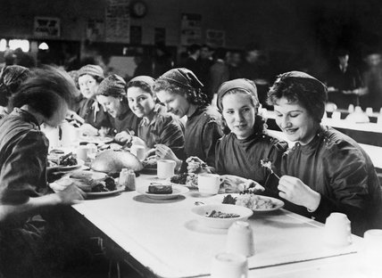 New recruits to the Slough Training Centre enjoy their evening meal in the canteen during 1941.