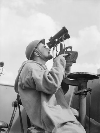 An Anti-Aircraft Control Spotter at his observation post on board an anti-aircraft ship in 1940.