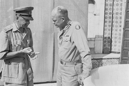 General Alexander, Deputy Commander-in-Chief Allied Forces in North Africa, discussing future operations with the Supreme Commander, General Eisenhower, in Tunisia, 26 July 1943.