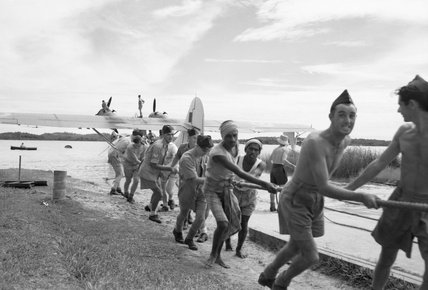 RAF groundcrew and local Singhalese lowering a Consolidated Catalina of No. 240 Squadron RAF into the water at Red Hills Lake, Ceylon, after undergoing repairs, 4 August 1945.