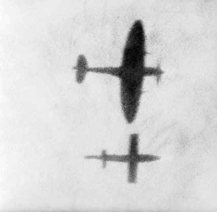 A Supermarine Spitfire flying alongside a V-1 flying bomb in an attempt to disrupt the airflow over its wing and force it to crash, August 1944.