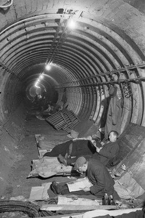 Londoners spending the night in a tunnel of the London Underground network, probably at Aldwych, in November 1940.