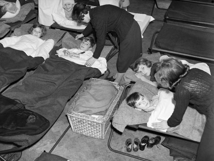 Homeless and orphaned children settle down to sleep in the air raid shelter at John Keble Church, Mill Hill, London during the Blitz in 1940.