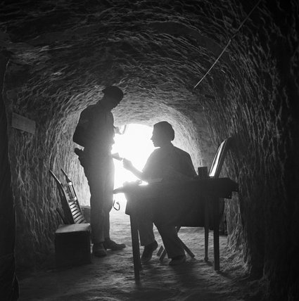 The commanding officer of an armoured unit receives a message at his HQ located in a tunnel within the Tobruk perimeter, 12 September 1941.