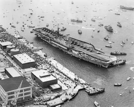 HMS HERMES about to berth at Portsmouth Harbour on her return from the Falkland Islands, 21 July 1982.