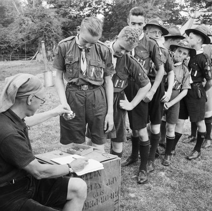 Pay Day for Boy Scouts at a fruit-picking camp near Cambridge in 1943.