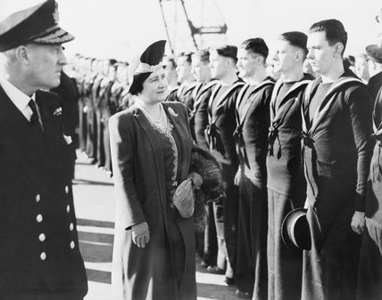 King George VI and Queen Elizabeth visiting HMS IMPLACABLE.