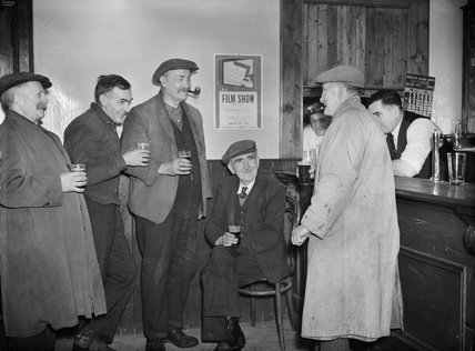 Regulars in the village pub in Tomintoul, Banfshire, discuss the Ministry of Information film show, held in the local Memorial Hall, 1943.