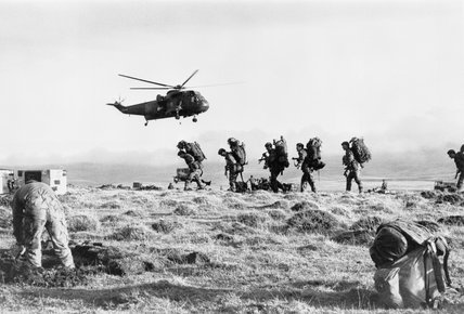Royal Navy Sea King Helicopters transport troops up to Darwin from San Carlos on the Falkland Islands, June 1982.