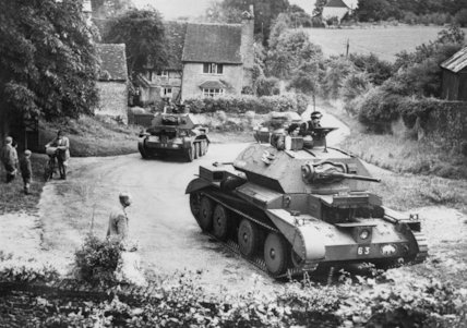 Cruiser Mk IV tanks of 5th Royal Tank Regiment, 1st Armoured Division, driving through a Surrey village, July 1940.