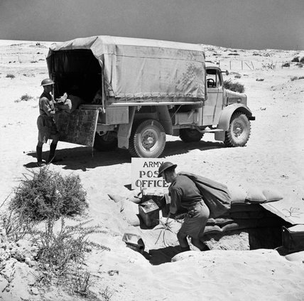Mail being unloaded from an Army Post Office lorry in the Western Desert, 16 July 1941.