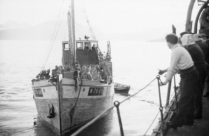 A boat load of Royal Engineers leaves HMS CAIRO on board a Motor Fishing Vessel to land at Narvik in Norway, June 1940.