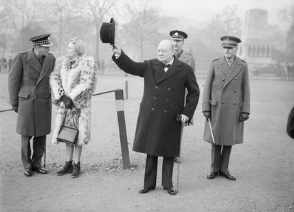 Winston Churchill raises his hat in salute during an inspection of the 1st American Squadron of the Home Guard at Horse Guards Parade in London, 9 January 1941.