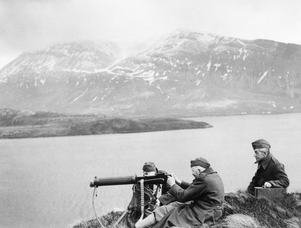 Members of the Home Guard man a Vickers machine-gun on the shores of Loch Stack in the Highlands of Scotland, 14 February 1941.