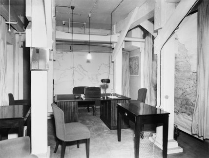 The Prime Minister's bedroom in the Cabinet War Rooms basement, showing the desk from which Churchill made his wartime broadcasts in 1940-1941.