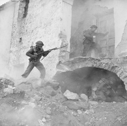 Staged reconstruction of infantry clearing buildings in Cassino, Italy, 24 March 1944.