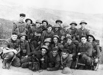 A platoon from 1st Battalion The Black Watch pose for the camera before going out on patrol, Korea, 1952.