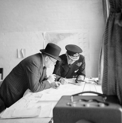 Winston Churchill studies after action reports with Vice Admiral Sir Bertram Ramsay, Flag Officer Comanding Dover, 28 August 1940.