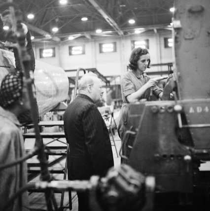 Winston Churchill watches a female riveter at work on a Supermarine Spitfire at the Castle Bromwich factory in Birmingham, 28 September 1941.