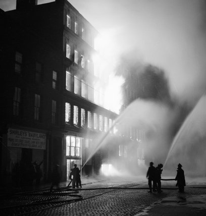 Buildings burning in Manchester during a German air raid on the night of 3 December 1940.
