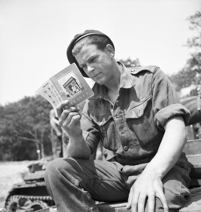 A soldier from 101st Light Anti-Aircraft Regiment prepares for D-Day by reading his French handbook at a camp near Portsmouth, 29 May 1944.