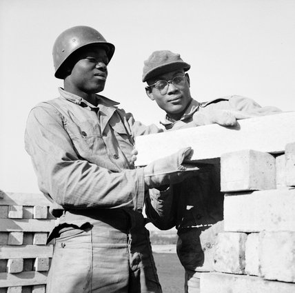 Black American soldiers engaged in railway construction work in Britain, 7 October 1943.