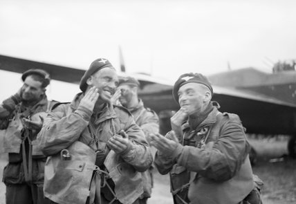 Paratroops of 6th Airborne Division blackening their faces in front of an Albemarle aircraft at RAF Harwell, 5 June 1944.
