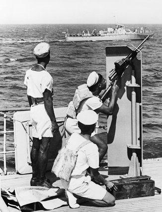 Members of the Trinidad Royal Naval Volunteer Reserve at gun drill with a light machine gun on board a Motor Launch, September 1944.