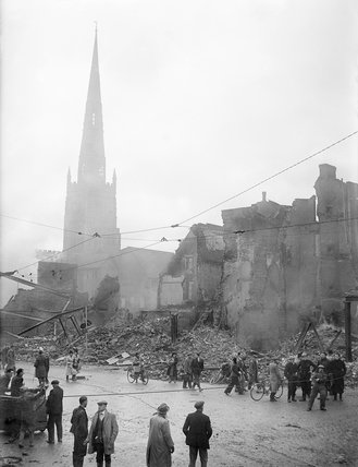 Holy Trinity Church rises above a scene of devastation in Coventry following the Luftwaffe air raid on the night of 14/15 November 1940.