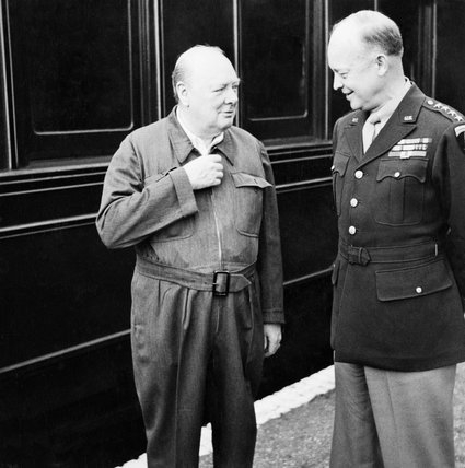 Winston Churchill shows off his famous 'siren suit' to General Dwight D Eisenhower, during a tour of Allied invasion forces in Kent, 12 May 1944.