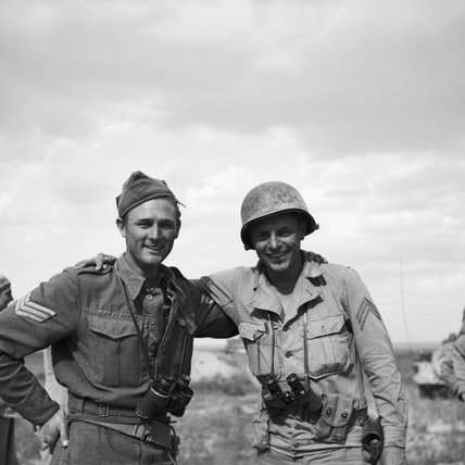 Lance Sergeant Brown and Sergeant A Randall of the 1st US Armoured Division were the first two men to meet during the link-up between the British Eighth and US First Armies in Tunisia, 7 April 1943.