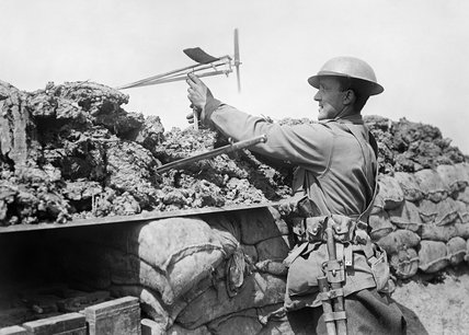 Australian soldier in the trenches at Croix du Bac, near Armentieres, using a wind direction indicator to assess the likelihood of a gas attack, 18th May 1916.