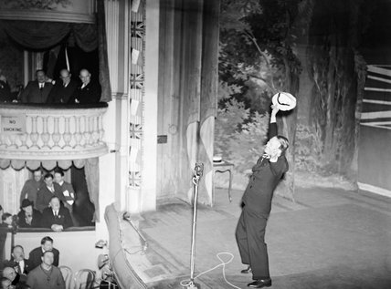 Maurice Chevalier entertains troops at the Apollo Theatre in Lens, France, 16 November 1939.