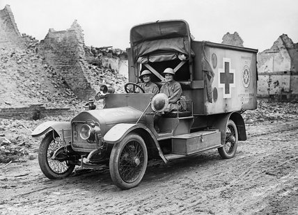 The two 'Women of Pervyse', Mairi Chisholm and the Baroness de T'Serclaes driving their motor ambulance through the ruins of Pervyse.