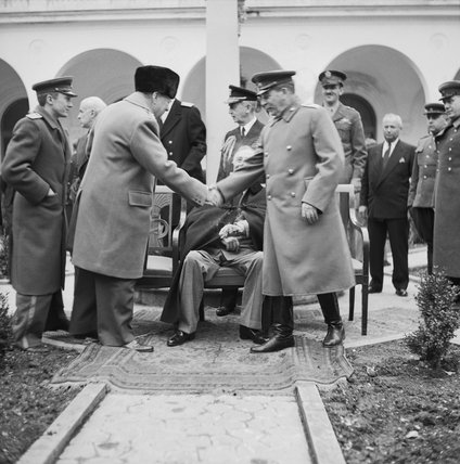 Winston Churchill greets Joseph Stalin with President Roosevelt outside the Livadia Palace during the Yalta Conference, February 1945.