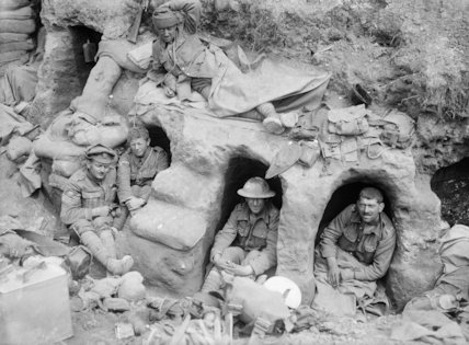 Men of the Border Regiment resting in shallow dugouts near Thiepval Wood, Somme, August 1916.