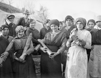 A group of young Italian women employed by the British Army to unload artillery ammunition at a railhead dump in northern Italy, 1918.