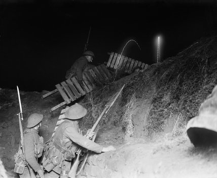 A fatigue party carrying duckboards out of a support line trench at night, Cambrai, 12 January 1917.