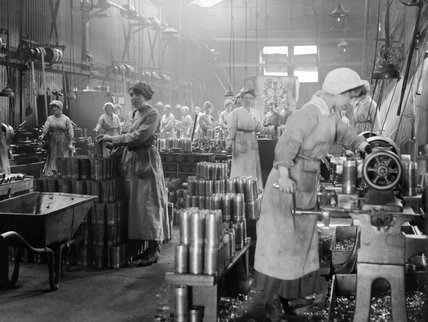 Women munition workers turning copper bands for artillery shells during the First World War at Royal Shell Factory 3, Woolwich Arsenal, London.