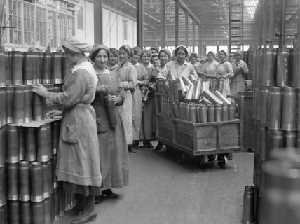Women munition workers stacking shell cases in the New Case shop at the Royal Arsenal, Woolwich during May 1918.
