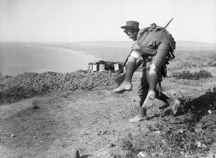 An Australian carrying his wounded mate to a medical aid post for treatment, Gallipoli, 1915.