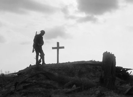 A British soldier stands besides the grave of a comrade near Pilckem during the Third Battle of Ypres, 22 August 1917.