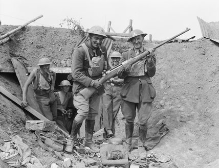 New Zealand gunners in a German emplacement pose with a captured German anti-tank rifle, near Grevillers, 25 August 1918.