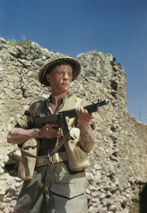 Corporal M Smith of the Duke of Cornwall's Light Infantry, posing with a Thompson sub-machine gun in the San Angelo area of Italy, April 1944.