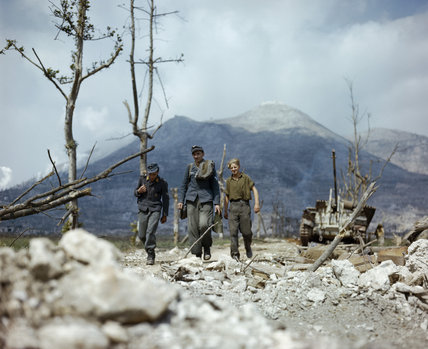 Three German prisoners walking back through the Allied lines at Cassino in Italy, May 1944.