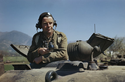 Sergeant A G Williams of the 17th/21st Lancers in the turret of his Sherman tank at San Angelo in Italy, April 1944.