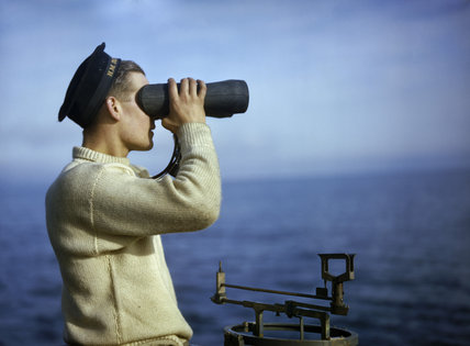 leading seaman walker keeps a look out from the bridge of hm submarine tribune